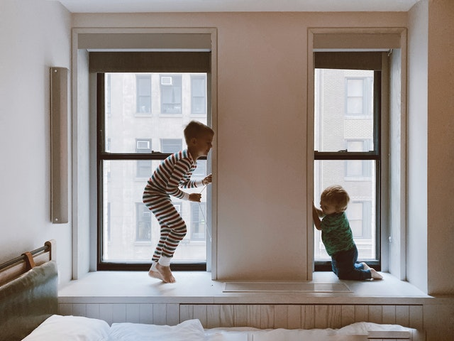 toddler and baby playing